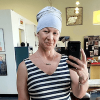 Lisa taking a selfie wearing a Chemocessories gift set